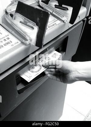 Retrait d'argent au distributeur