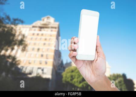 Image composite de portrait of businesswoman holding smart phone