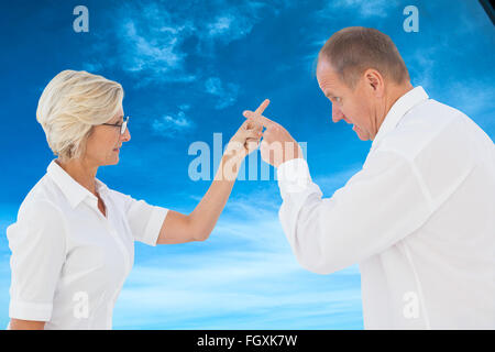 Image composite du couple plus âgé en colère les uns avec les autres Banque D'Images