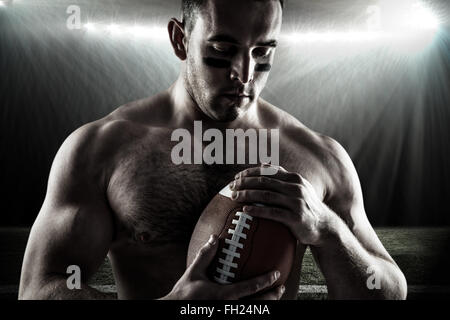 5811697bde ... Image composite de shirtless american football player with ball Banque  D'Images