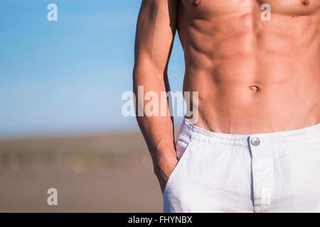 Espagne, Ténérife, close-up of man standing on the beach Banque D'Images