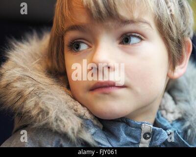 Portrait Of Boy Wearing Fur Jacket In Car Banque D'Images