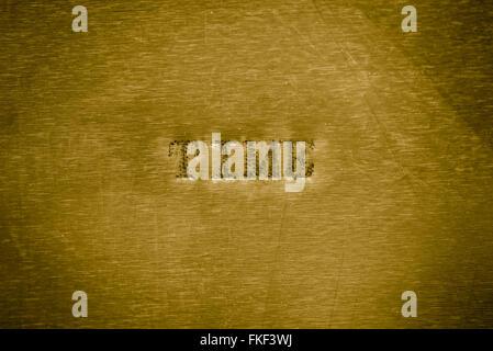 Temps mot imprimé sur texture de fond métallique d'or Banque D'Images