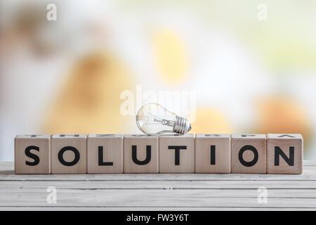 Ampoule sur une solution signe fait de cubes Banque D'Images