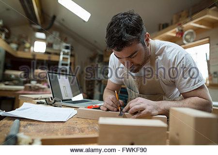 Menuisier bois atelier en bloc de marquage Banque D'Images