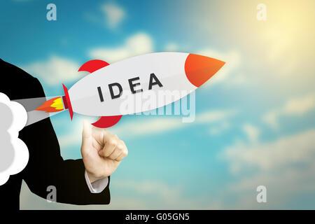 En cliquant sur la main d'affaires idée modèle plat rocket Banque D'Images