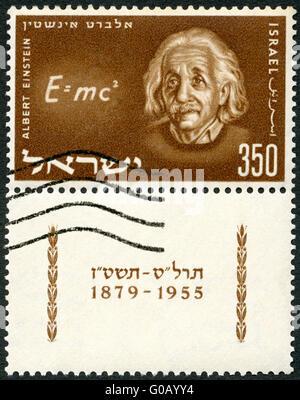 Israël - 1956: montre Albert Einstein (1879-1955) et l'équation de sa théorie de la relativité Banque D'Images