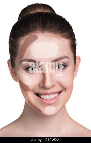 Femme de visage. Contour et mettez en surbrillance le maquillage. Isolated on white Banque D'Images