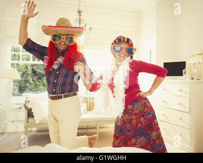 Portrait silly mature couple dancing in costumes Banque D'Images