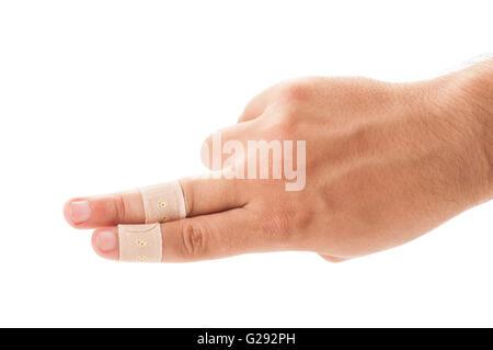 Deux doigts patché avec le plâtre sur fond blanc Banque D'Images