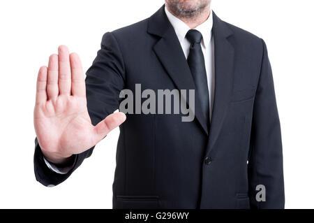 Anonymus business man showing geste d'arrêt en soulevant l'appareil de palm Banque D'Images