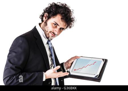 Un jeune et beau businessman holding a tablet isolé sur fond blanc Banque D'Images