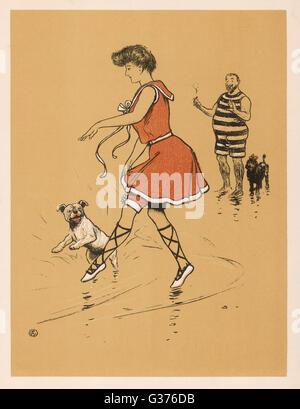 Une jeune femme (Michelle2103) dans un maillot rouge, avec son bouledogue blanc sur la plage à Ostende. Un homme Banque D'Images