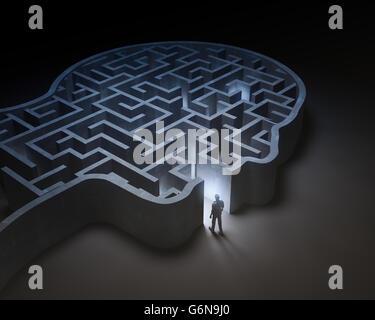 L'homme entrant dans un labyrinthe à l'intérieur d'une tête - 3D illustration Banque D'Images