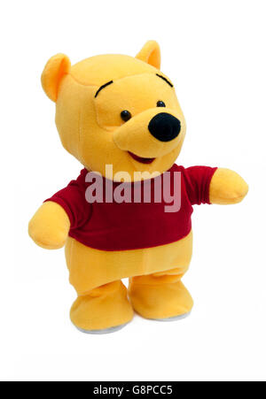 Ours en peluche jaune isolé sur fond blanc Banque D'Images