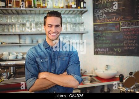 Portrait of handsome cafe owner Banque D'Images
