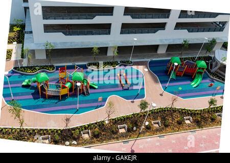 Aire de jeux pour enfants dans de nouveaux logements publics de Singapour (logement du développement a) les immeubles Banque D'Images