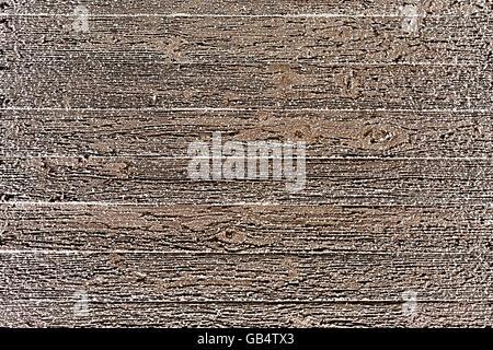 Mur en bois recouvert de givre Banque D'Images