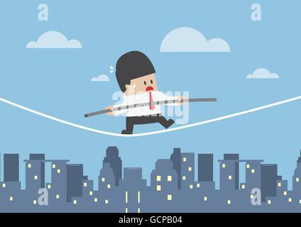 Businessman walking sur une corde sur la ville, le concept de risque d'entreprise Banque D'Images