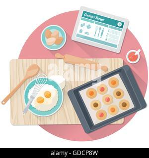 Savoureuse cuisine des cookies dans la cuisine avec ustensiles et digital tablet Banque D'Images