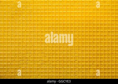 Surface texturée wafer jaune arrière-plan gros plan Banque D'Images