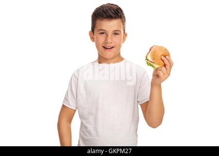 Petit garçon ayant un sandwich isolé sur fond blanc Banque D'Images