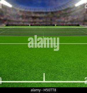 Court de tennis sur gazon plein de spectateurs dans les tribunes. L'accent sur le premier plan délibéré avec une Banque D'Images