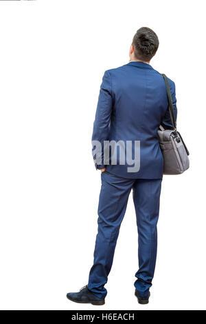 Full Length portrait of young woman in blue de même. Jeune homme donner en retour à l'appareil photo montrant vue Banque D'Images
