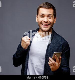 Cheerful young man in smart casual wear Banque D'Images