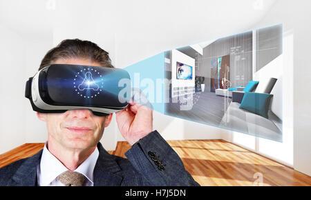 Homme avec casque VR dans une pièce virtuelle Banque D'Images