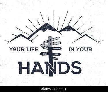 L'étiquette à la main avec des montagnes, d'inspiration et d'orientation pour les signer - votre vie dans vos mains. Banque D'Images