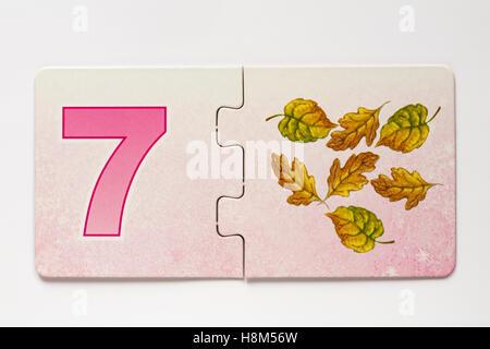 Shirley Barber's Fairies Nombre Match jigsaw puzzle pieces - Numéro 7 Banque D'Images