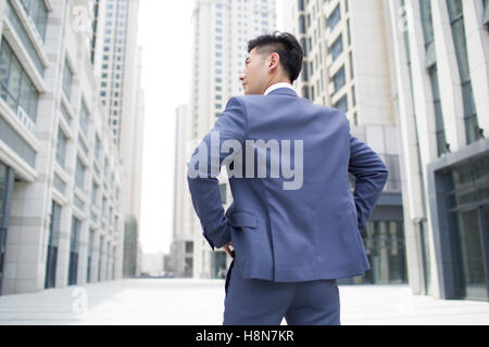 Confiant Chinese businessman looking at view Banque D'Images