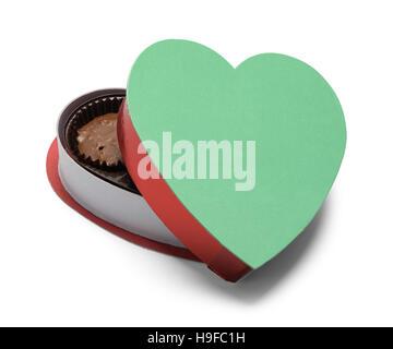 Boîte de chocolats à coeur ouvert isolé sur fond blanc. Banque D'Images