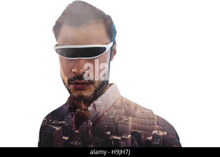 Composite image de l'homme à l'aide d'un appareil de réalité virtuelle Banque D'Images
