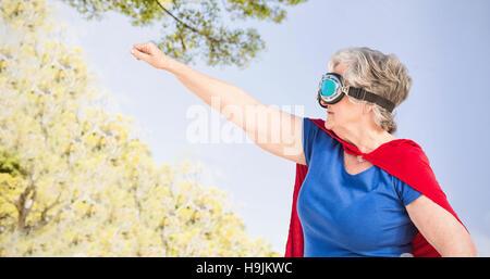 Composite image of senior woman wearing costume superwoman Banque D'Images