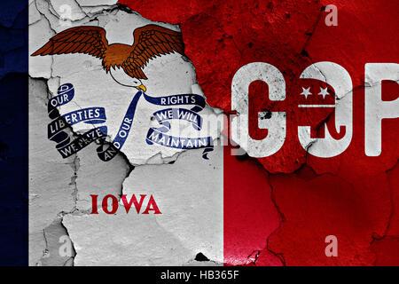 Drapeau de l'Iowa et le gop peint sur mur fissuré
