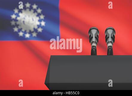 Chaire et deux microphones avec un drapeau sur le fond - Birmanie Banque D'Images