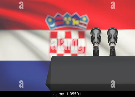 Chaire et deux microphones avec un drapeau sur le fond - Croatie Banque D'Images
