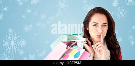 Image composite de femme portant un foulard et holding shopping bags Banque D'Images