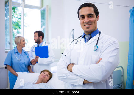 Smiling doctor standing in hospital