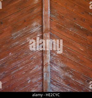 Vieux et patiné en bois peint texture porte rouge Banque D'Images