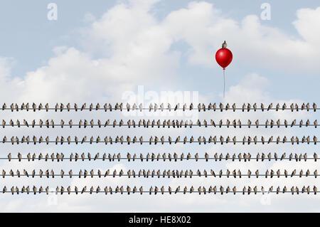 Concept de penser différentes qu'un groupe d'oiseaux sur un fil avec un déménagement vers le haut comme un oiseau Banque D'Images