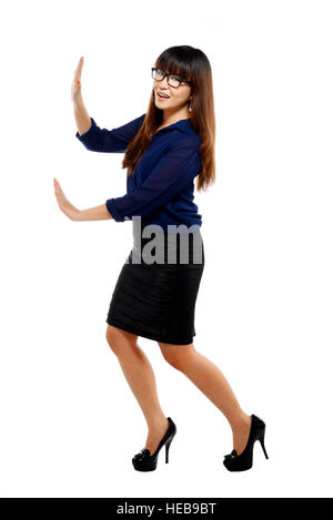 Business Woman pousser un objet imaginaire isolated over white background Banque D'Images
