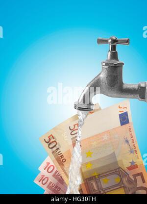 Un robinet d'eau (robinet) et l'introduction des billets (composer): symbole pour blanchiment Banque D'Images