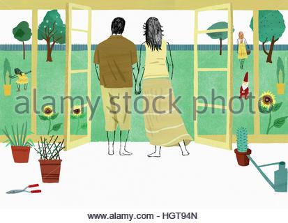 Couple holding hands looking out at filles en jardin d'hiver Banque D'Images