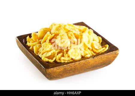 Des Cornflakes dans bol en bois isolé sur fond blanc Banque D'Images