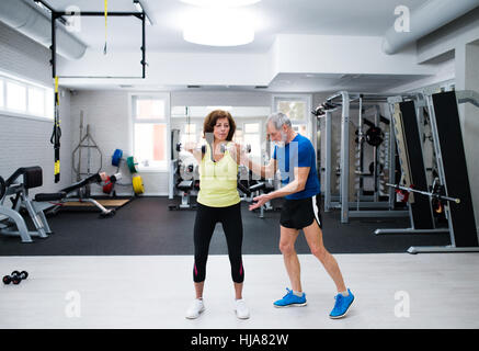 Senior couple in working out with weights