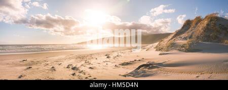 Le coucher du soleil, la baie de phlébotome, Dunedin, Otago Peninsula, Southland, Nouvelle-Zélande Banque D'Images