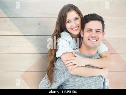 Man giving piggyback ride to woman Banque D'Images